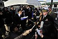 US Navy 100119-N-0807W-158 Capt. Francis X. Martin, commander of Fleet Activities Sasebo, speaks with Japanese media at a ceremony celebrating the 50th anniversary of the signing of the Treaty of Mutual Cooperation and Security.jpg
