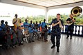 US Navy 100314-F-4109M-047 Musician 2nd Class Justin Strauss and Musician 2nd Class Allison Baine entertain boys and girls from the Egyam Orphanage Foundation.jpg