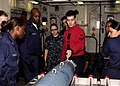 US Navy 100405-N-9116S-067 Aviation Ordnanceman 1st Class William J. Doyle instructs other Sailors on the assembly of an inert guided bomb.jpg