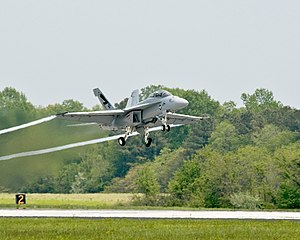 "2010 in aviation - A United States Navy F/A-18 Super Hornet – the ""Green Hornet"" – making a biofuel-powered flight at Naval Air Station Patuxent River, Maryland, on 22 April 2010."