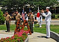 US Navy 100531-N-2218S-002 Musician 2nd Class Collin Reichow, from Hendon, Va., plays taps at a Memorial Day ceremony at the USS Oneida memorial at Fleet Activities Yokosuka.jpg