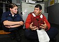 US Navy 100818-N-3705H-189 Damage Controlman 1st Class Robert Perez goes over chemical, biological, and radiological advanced damage control training with Cryptologic Technician (Collection) 3rd Class Michelle Hunter.jpg