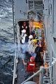 US Navy 110210-N-6006S-054 Gunner's Mate Seaman William Stafford fires a shot line from USS Bunker Hill (CG 52) to USNS Henry J. Kaiser (T-AO 187).jpg
