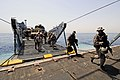 US Navy 110601-N-RC734-164 Marines disembark Landing Craft Utility (LCU) 1648 during stern gate marriage operations aboard USS Comstock (LSD 45).jpg