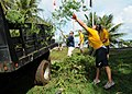 US Navy 110924-N-BT122-481 Sailors pick up trash during a community service project at the War in the Pacific National Historical Park.jpg