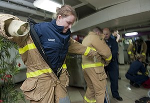 US Navy 120109-N-DR144-024 Machinist's Mate 1st Class Elizabeth Howard dons a firefighting ensemble.jpg