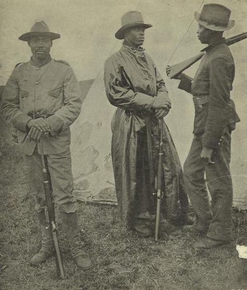 Three African-American soldiers posing in uniform, late 1800's.