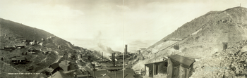 Panorama of the United Verde Smelter as it appeared in about 1909, replete with smoking smokestacks, many small buildings, and a curved section of railroad track