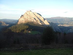 Durango, Biscay - The limestone summits of Urkiola; Durango is seen in the background.