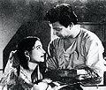 Uttam-Kumar-and-Suchitra-Sen-in-Bangla-Movie-Harano-Sur---1957.jpg