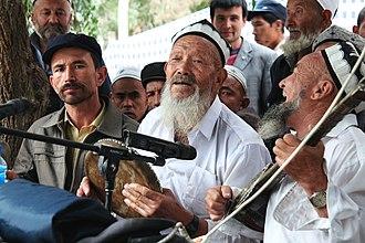 Uyghurs - Uyghur Meshrep musicians in Yarkand.
