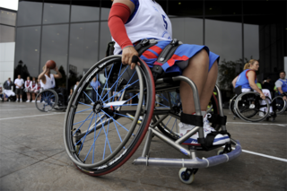 Wheelchair chair with wheels, used by people for whom walking is difficult or impossible due to illness, injury, or disability