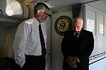 Vice President Cheney Talks with David Addington Aboard Air Force Two (18711315111).jpg