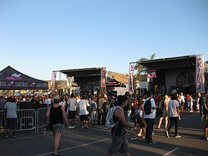 Warped Tour - The Alternative Press/Advent stage (left) and Glamour Kills stage (right) on the 2010 tour, an example of the tour's side-by-side stage setup. Acts play alternating 30-minute set times on the two stages.