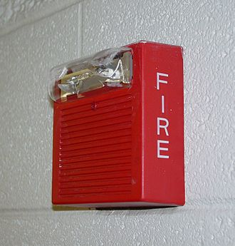 Warning system - A fire alarm that warns people if a building is on fire