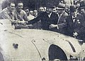 Wimille et Veyron vainqueurs, serrant la main du ministre des travaux publics, et celle du Président de l'ACO M. Singher (24 Heures du Mans 1939).jpg