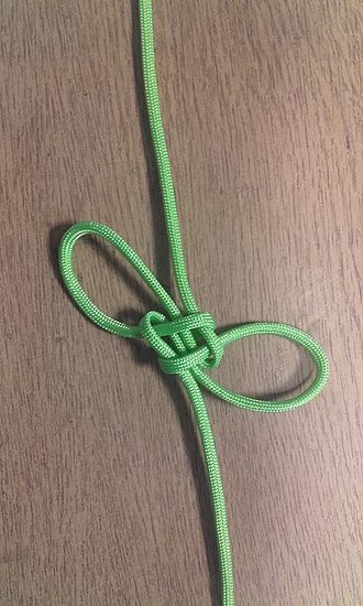 Friendship knot - A winged cross knot.