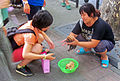 Woman selling puppies on Fuzhou Road sidewalk, Shanghai.jpg