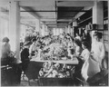 Women assembling dolls on a long worktable at the Shrenhat Toy Company, Philadelphia, 10-1912 - NARA - 523031.tif