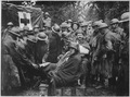 Wounded German prisoners receiving medical attention at first-aid station of 103rd and 104th Ambulance Companies.... - NARA - 530754.tif