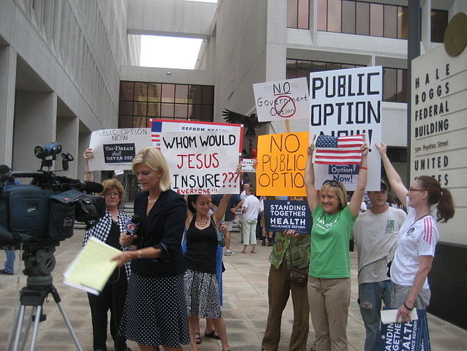 Pro and anti healthcare protesters vie for spa...