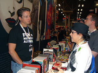 Top Cow Productions - Top Cow President Matt Hawkins (left) speaking with fans (right) at the Image Comics booth at the 2012 New York Comic Con.