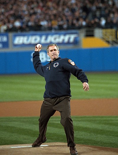 Donning an FDNY fleece, with a bulletproof vest underneath, President Bush tosses out the ceremonial first pitch. 2001 World Series first pitch.jpg