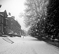 21st Jan 2015. South-westerly view down Broadwalk, Buxton, Derbyshire, in the snow, with the Pavilion Gardens on the right. IMG 20150121 122351 - panoramio.jpg