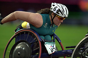Louise Sauvage - Action shot of Sauvage on her way to winning silver in the 800 m T54 wheelchair race at the 2000 Summer Paralympics