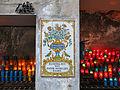 235 Basílica de Montserrat, camí de l'Ave Maria, plafó ceràmic i ciris.JPG