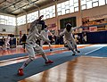 2nd Leonidas Pirgos Fencing Tournament. The fencer Achilleas Mavromatis parries the flèche of his opponent.jpg