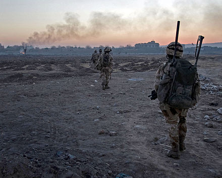 Members of Whiskey Company, 45 Commando Royal Marines patrolling across barren landscape from FOB (Forward Operating Base) Jackson at Sangin in Helmand Province in Afghanistan. 45 Cdo Royal Marines in Afghanistan MOD 45149706.jpg