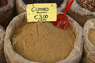 Cumin - Ground cumin on display at the market in Ortigia, Syracuse (Italy)