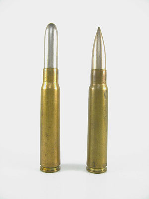 7.92×57mm Mauser - 1888 pattern M/88 (left) parent cartridge alongside the 1903 pattern 7.92×57mm Mauser S Patrone.
