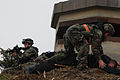 A U.S. Air Force Airman from the security forces handcuff two opposing forces members during a simulated attack as part of exercise Beverly Midnight 07-01, at Osan Air Base, South Korea, March 27, 2007 070327-F-IF940-224.jpg