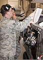 A U.S. Air Force staff sergeant, left, serving as an instructor, helps Senior Airman Joseph Szymanski, with the 361st Training Squadron, check an electrical wiring diagram to troubleshoot an electrical problem 110608-F-NS900-012.jpg