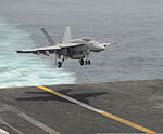 A U.S. Navy F-A-18E Super Hornet aircraft assigned to Strike Fighter Squadron (VFA) 147 lands aboard the aircraft carrier USS Nimitz (CVN 68) Aug. 1, 2013, in the Gulf of Oman 130801-N-TI017-041.jpg