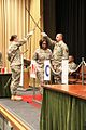 A newly inducted NCO walks beneath the crossed swords. (6918127980).jpg