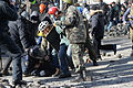 A police officer attacked by protesters during clashes in Ukraine, Kyiv. Events of February 18, 2014-1.jpg