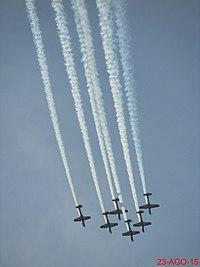 """Academia da Força Aérea (AFA) em Pirassununga-SP. Aviões Super Tucano A-29 da Fumaça na segunda apresentação no Domingo Aéreo 2015, no retorno da Esquadrilha da Fumaça ao """"Ninho das Águias"""" - panoramio (1).jpg"""