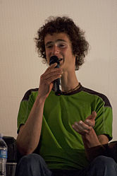 Adam Ondra speaking at Trento film festival.jpg