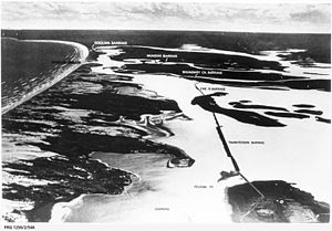 Goolwa Barrages - Aerial view of the River Murray barrages, with superimposed text providing locations of Goolwa barrage, Mundoo barrage, Boundary Creek barrage, Ewe Island barrage and Tauwitchere barrage, as viewed from the Coorong towards the Murray Mouth, circa 1940 (State Library of South Australia - PRG-1258/2/546).