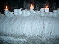 Agglomeration of melted candle wax, plus burning candles, in a Tallinn restaurant.jpg