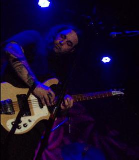 Al Cisneros American punk metal singer and guitarist