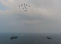 American and French aircraft fly in formation above the aircraft carriers USS Harry S. Truman (CVN 75), left, and FS Charles de Gaulle (R 91) 140131-N-ZZ999-044.jpg