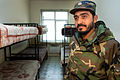 An Afghan National Army soldier stands by a typical barracks room (4279008331).jpg