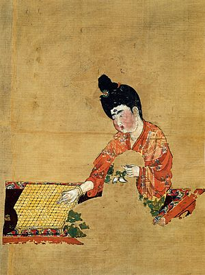 Tarim Basin - Fragmentary painting on silk of a woman playing the ''go'' boardgame, from the Astana Cemetery, Gaochang, c. 744 AD, during the late period of Tang Chinese rule (just before the An Lushan Rebellion)