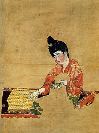 Go (game) - Woman Playing Go (Tang Dynasty c. 744), discovered at the Astana Graves