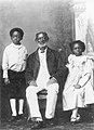 Aquasi Boachi with his children.jpg