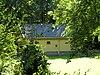 foto van Vrijstaand koetshuis bij het huis